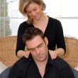 Woman giving a massage - Foto Stock