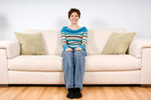 Woman on couch — Stock Photo