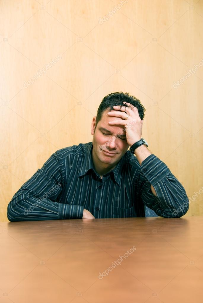 Business man looking tired and depressed from over work — Stock Photo #12424847
