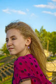 Preteen female outdoors on a sunny, breezy day — Stock Photo