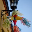 Stock Photo: Streetlamp with piñata