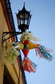 Streetlamp with a piñata — Stock Photo