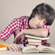 Tinager student falls asleep doing homework — Stock Photo
