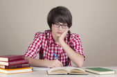 Nerd Schoolboy Studies His Homework — Stock Photo