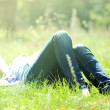 Stock Photo: Girl lies on grass