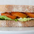 Royalty-Free Stock Photo: Sandwich of cured ham, tomatoes and lettuce
