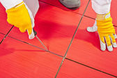 Sharp tool clean spaces between tiles — Stock Photo