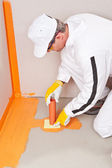 Plumber applied waterproofing cuff on the floor of the bathroom — Stock Photo
