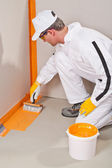 Worker waterproofing around the wall and floor — Stock Photo