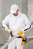 Worker cutting lath by stencil — Stock Photo