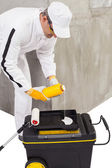 Worker pouring a primer in a paint tray — Stock Photo