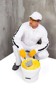 Worker mixing a plaster with a trowel — Stock Photo