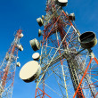 Telecommunication towers with blue sky — Stock Photo #33609407