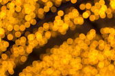 Elegant abstract background with bokeh defocused golden lights — Stock Photo