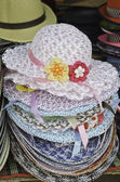 Pile of decorated straw hats ready to sell — Stock Photo