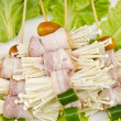 Enoki mushrooms wrapped with pork bacon, prepared for barbeque — Stockfoto