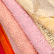 Fabric store with stacks of colorful lace textiles — Stock Photo