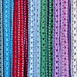 Colorful handcrafted belts with beads — Stock Photo