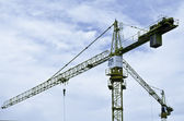 Crane at construction site against blue and cloud sky — Stock Photo