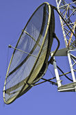Satellite dish on a telecommunications tower — Стоковое фото