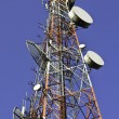 Telecommunication towers against blue sky — Stock Photo #46094339