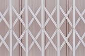 Pink metal grille sliding door with aluminium handle  — Foto de Stock