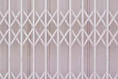 Pink metal grille sliding door — Stock Photo