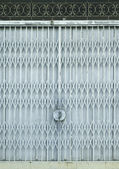 Light blue old metal grille sliding door — Stock Photo
