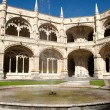 Shy rainbow in the Jeronimos inner courtyard - Stock Photo