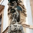 Sculptures that decorate building at the entrance to the Prague — Stock Photo #12461940