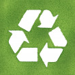 Recycle symbol made on grass outlines — Stock Photo