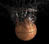 Basketball falls into water — Stock Photo