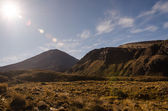 Mount Ngauruhoe with sun glare, Tongariro National Park, New Zealand — Stock Photo