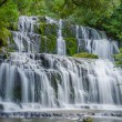 Purakaunui Falls, The Catlins, south island of New Zealand. Beautiful stairway waterfall. - Stock Photo