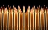 Rifle bullets lined in formation. 3d illustration. — Stock Photo