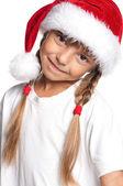 Little girl in Santa hat — Stock Photo