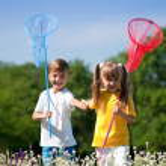 Happy children on meadow — Stock Photo #12571626
