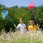 Happy children on meadow — Stock Photo #12578121