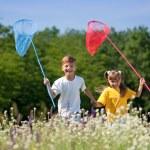 Happy children on meadow — Stock Photo #12623652