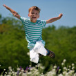 Happy boy on meadow — Stock Photo #12799638