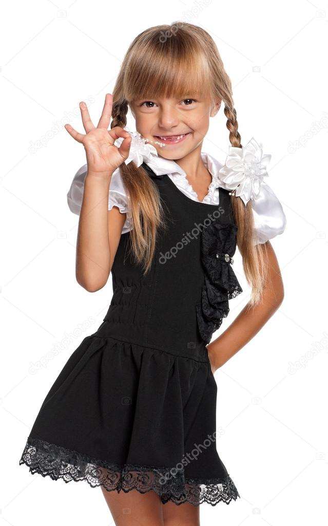 Little girl in school uniform - Stock Image