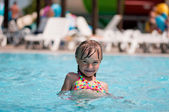 Little girl at aqua park — Stock Photo