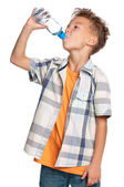 Boy with bottle of water — Stock fotografie