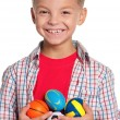 Boy with small balls — Stock Photo #13175515