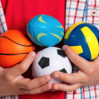 Boy with small balls - Stock Photo