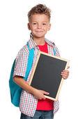 Boy with small blackboard — Stock Photo