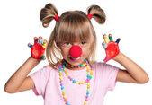Little girl with clown nose — Stock fotografie