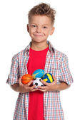 Boy with small balls — Stock Photo