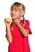Little girl with lemon — Stock Photo