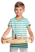 Boy with chessboard — Stock Photo